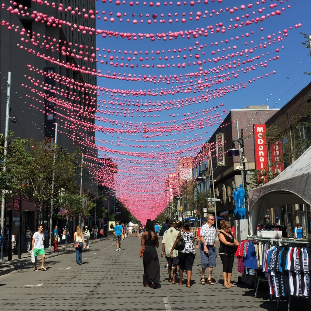 Pink lights hanging atop the length of Saint Catharine Street