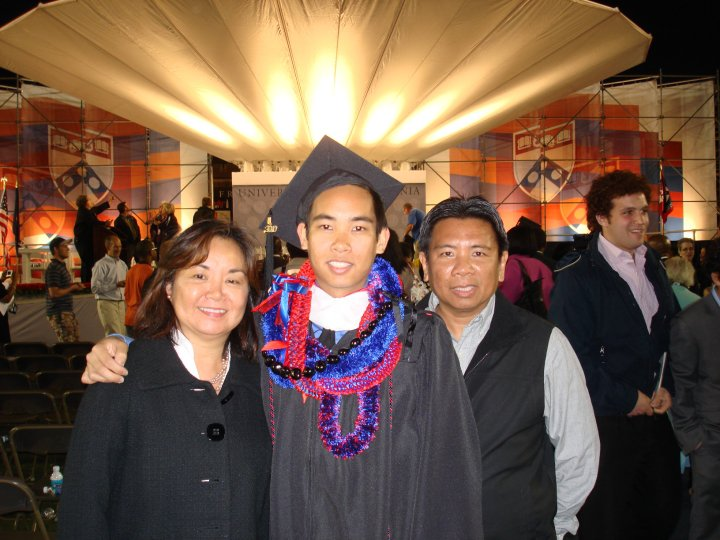 With my parents at my college graduation.