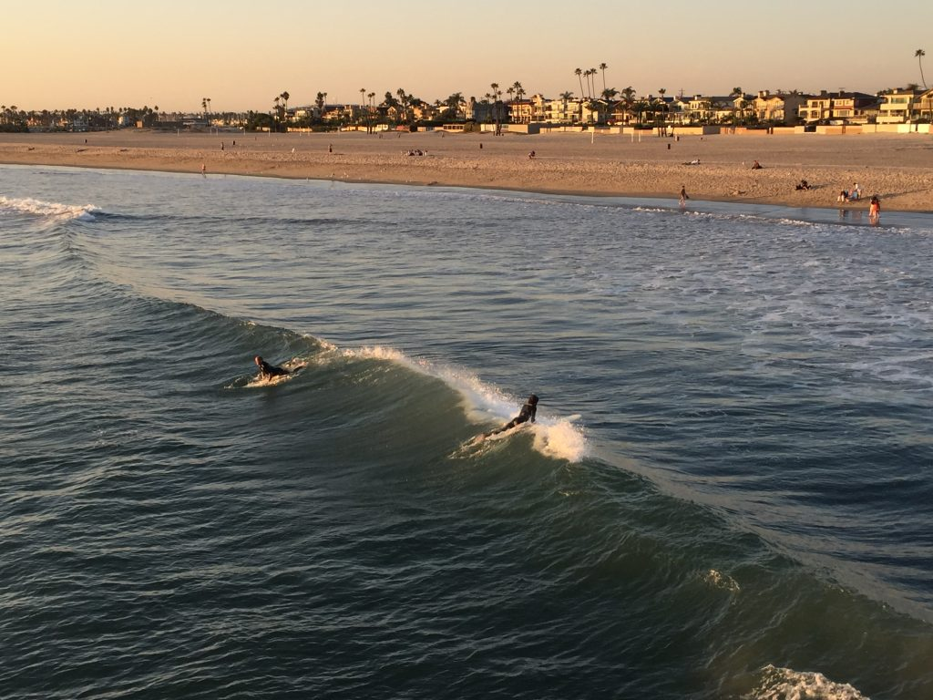 Surfers at Seal Beach, California